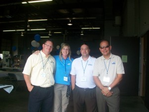 Bob Lundin (far left) at an IMED Open House in July 2010