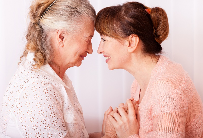 Caregiver smiles at loved one